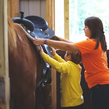 equestrian staff assisting